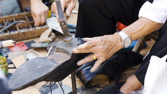 One of our team repairing a customers shoe